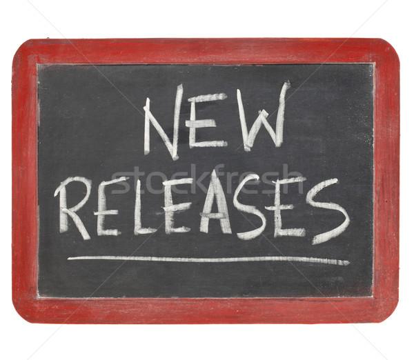 new releases blackboard sign Stock photo © PixelsAway