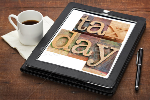 tax day reminder on digital tablet Stock photo © PixelsAway