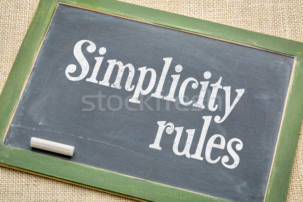 simplicity rules  blackboard sign Stock photo © PixelsAway