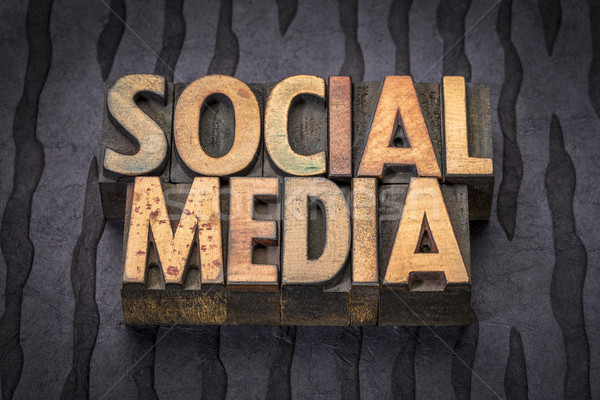 social media word abstract in wood type Stock photo © PixelsAway