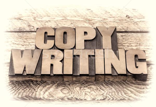 copywriting word in vintage letterpress wood type Stock photo © PixelsAway