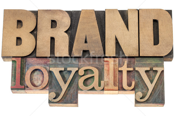 brand loyalty in wood type Stock photo © PixelsAway