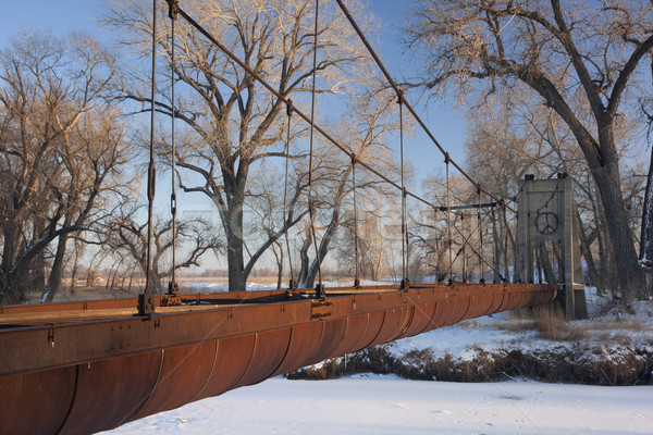 Stock photo: old rusty aqueduct across a river