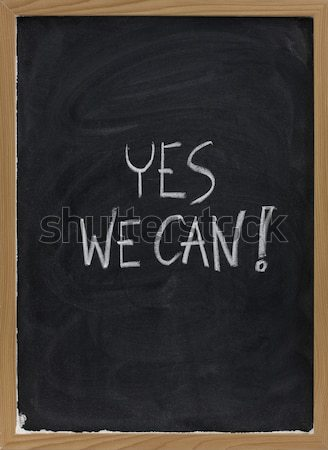 Yes we can - motivational slogan on blackboard Stock photo © PixelsAway
