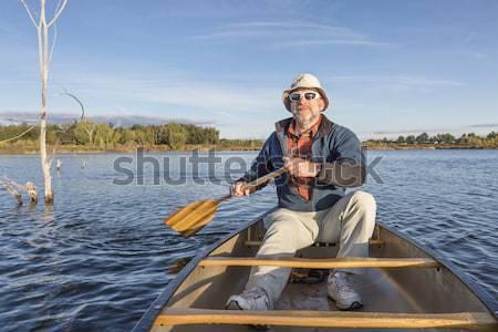 Canoa lago senior maschio mattina naturale Foto d'archivio © PixelsAway