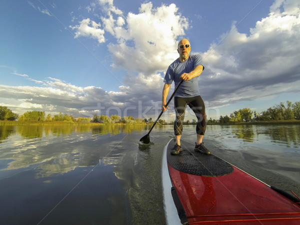 stand up paddling Stock photo © PixelsAway