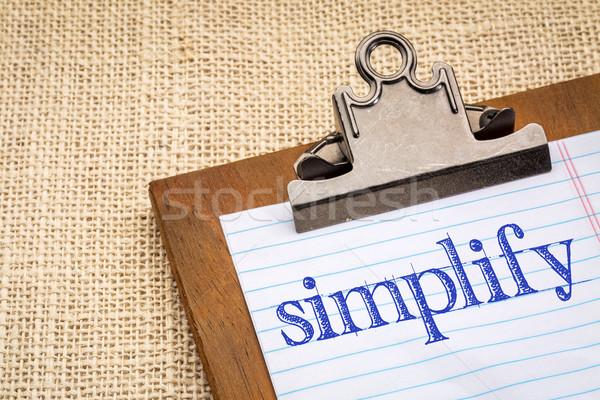 simplify word on a clipboard Stock photo © PixelsAway
