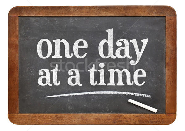 One day at a time on blackboard Stock photo © PixelsAway