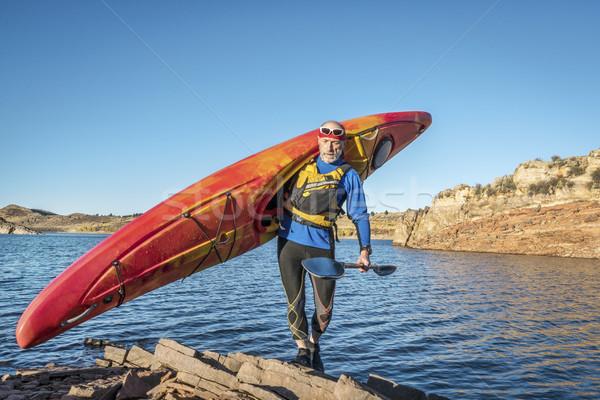 carrying river kayak on lake shore Stock photo © PixelsAway