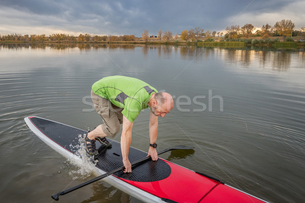 fitness on stand up paddleboard Stock photo © PixelsAway