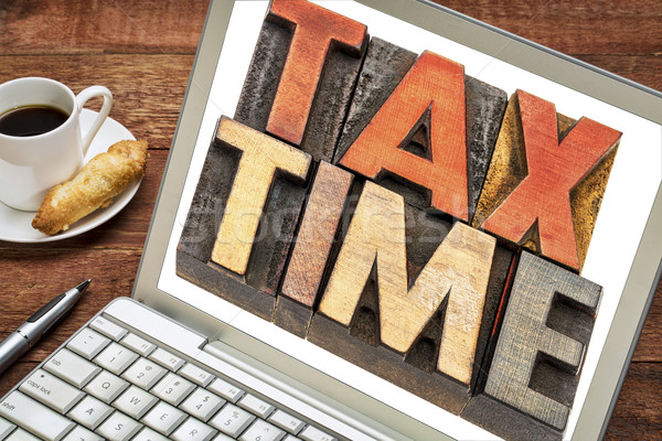 tax time word abstract on laptop Stock photo © PixelsAway
