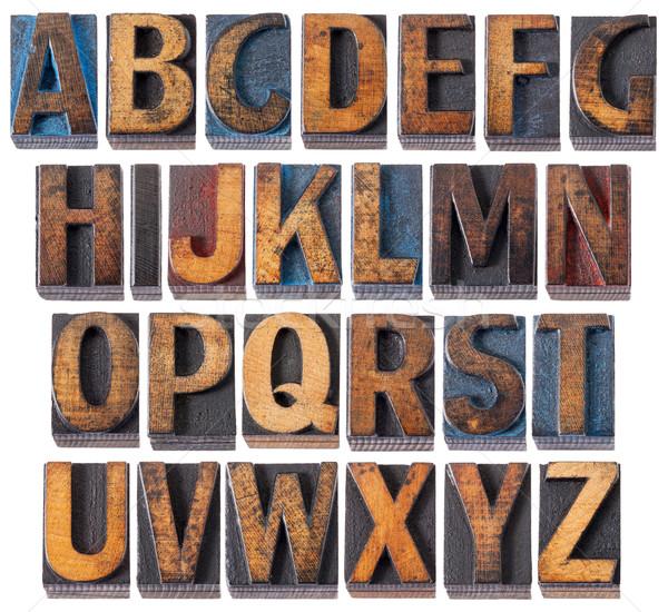 alphabet in antique wood type Stock photo © PixelsAway