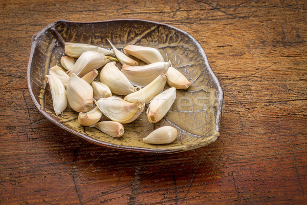 garlic cloves on a leaf bowl Stock photo © PixelsAway