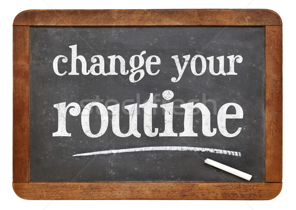 change your routine blackboard sign Stock photo © PixelsAway