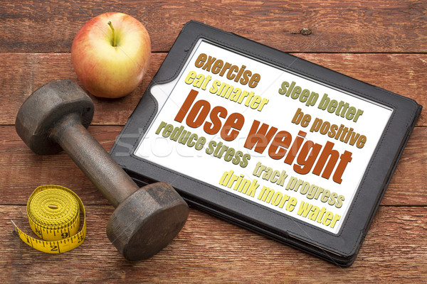 lose weight - tips on a tablet Stock photo © PixelsAway