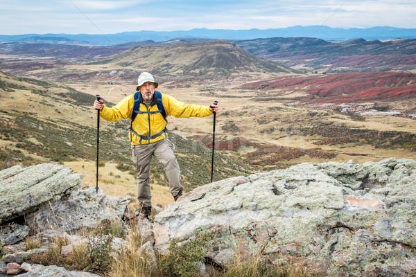 senior male hiker on rocky cliff Stock photo © PixelsAway