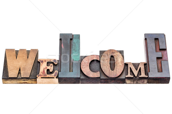 Welcome sign in mixed wood type Stock photo © PixelsAway