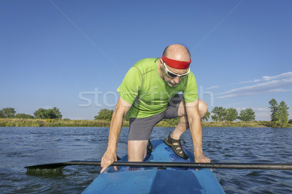 senior male paddler on paddleboard Stock photo © PixelsAway