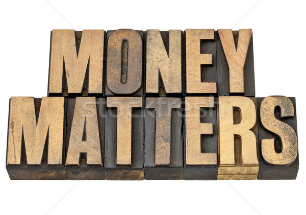 money matters in wood type Stock photo © PixelsAway