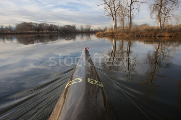 bow of racing kayak number thirteen on a calm lake Stock photo © PixelsAway