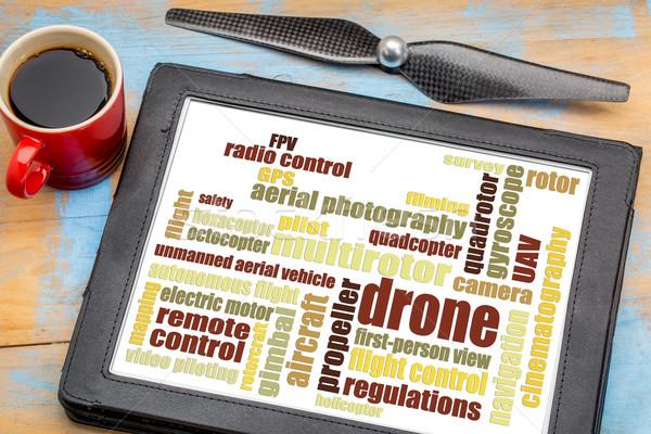 drone word cloud on digital tablet Stock photo © PixelsAway
