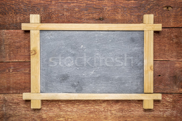 blank slate blackboard against wood Stock photo © PixelsAway