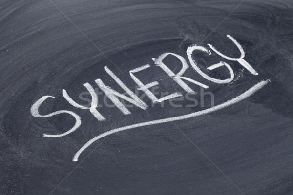 synergy word on blackboard Stock photo © PixelsAway