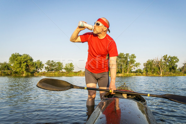Kajak drinkwater senior sport drinken training Stockfoto © PixelsAway