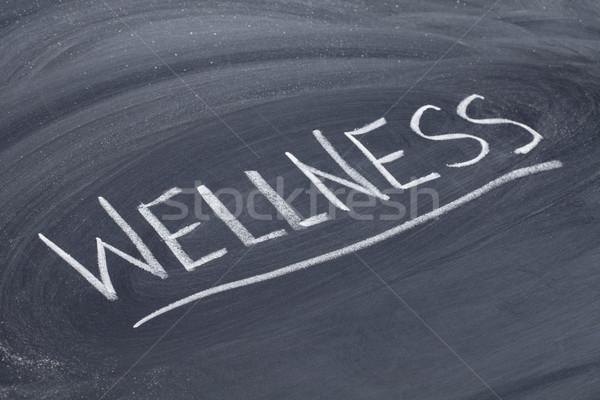 wellness word on blackboard Stock photo © PixelsAway