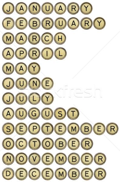 Doze meses máquina de escrever teclas dezembro isolado Foto stock © PixelsAway