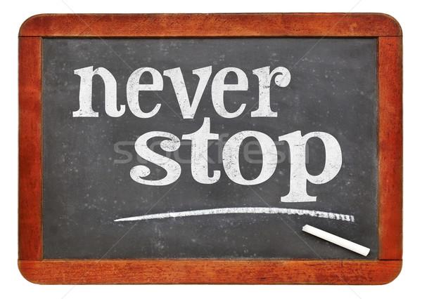 nver stop balckboard sign Stock photo © PixelsAway