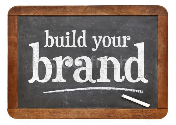 Construir marca pizarra signo blanco tiza Foto stock © PixelsAway