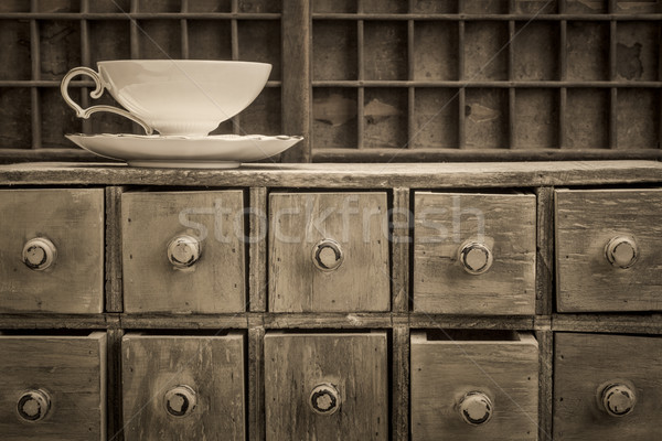 classic tea cup on top of rustic drawers Stock photo © PixelsAway