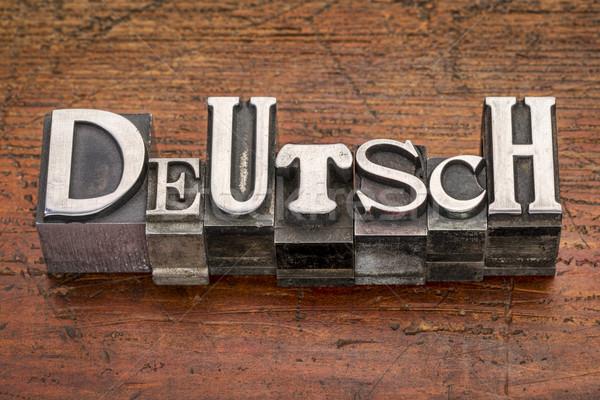 Deutsch word in metal type Stock photo © PixelsAway