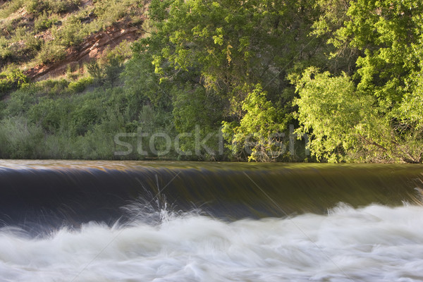 river diversion dam with white water and splashes Stock photo © PixelsAway