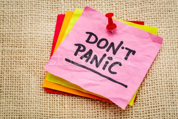 Do not panic on sticky note Stock photo © PixelsAway