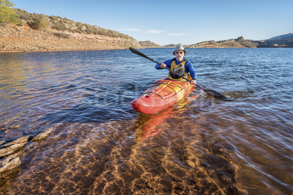 paddling  kayak on mountain lake Stock photo © PixelsAway