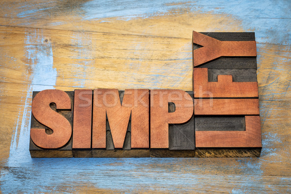 simplify word abstract in wood type Stock photo © PixelsAway