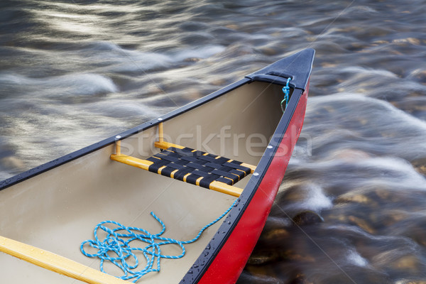 red canoe stern with a rope Stock photo © PixelsAway