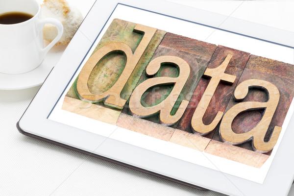 data word on  digital tablet Stock photo © PixelsAway
