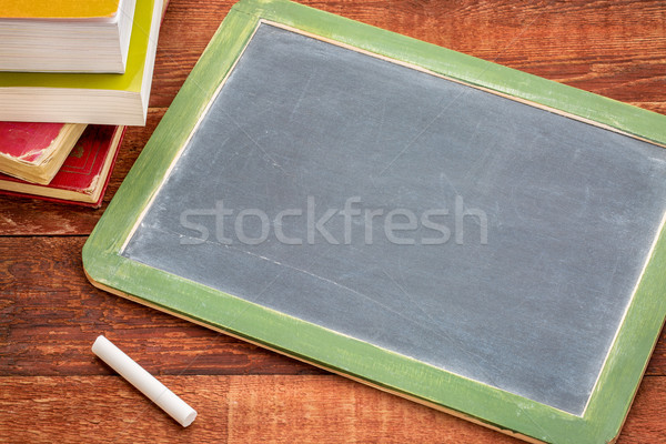 blank slate blackboard with chalk and books Stock photo © PixelsAway