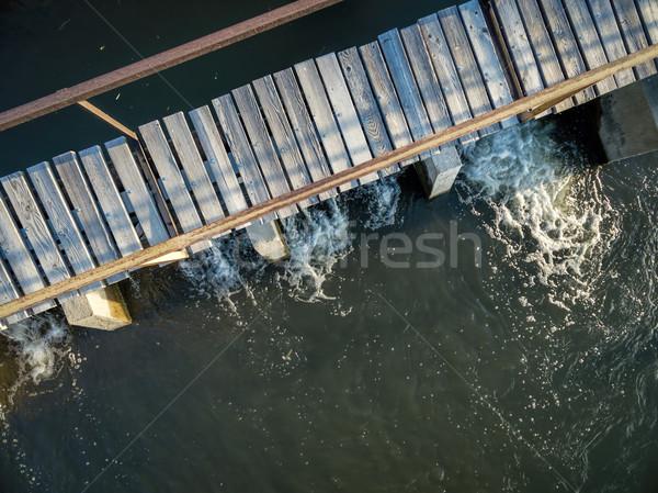 river diversion dam with foothbridge Stock photo © PixelsAway