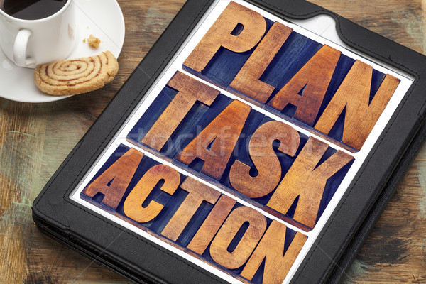 plan, task, action words on tablet Stock photo © PixelsAway