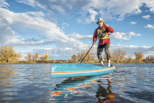 paddling stand up paddleboard  Stock photo © PixelsAway