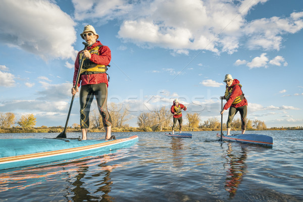 stand up paddling  workout Stock photo © PixelsAway