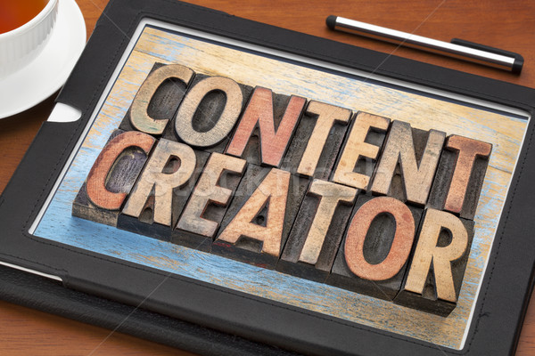 Stock photo: content creator  words in wood type