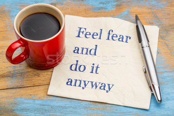 Feel fear and do it anyway - text on napkin Stock photo © PixelsAway