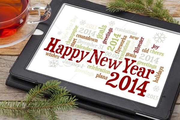 Gelukkig nieuwjaar 2014 woordwolk digitale tablet beker Stockfoto © PixelsAway
