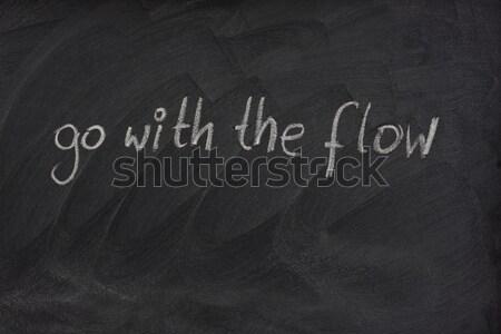 go with the flow phrase on blackboard Stock photo © PixelsAway