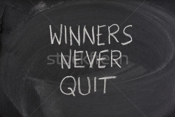 winners never quit phrase on blackboard Stock photo © PixelsAway